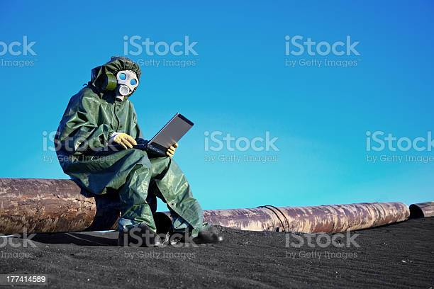 Scientist With A Laptop On Chemically Contaminated Area Stock Photo - Download Image Now