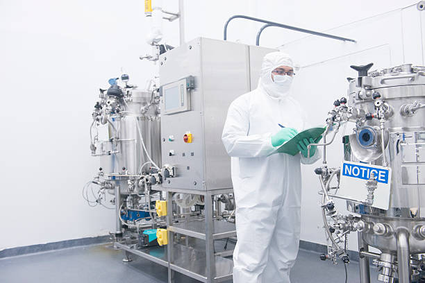 scientist with bioreactor - white suit stock photos and pictures