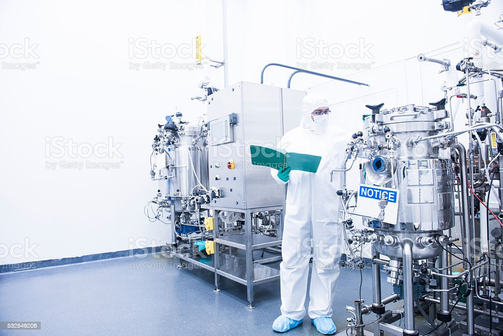 scientist with bioreactor stock photo