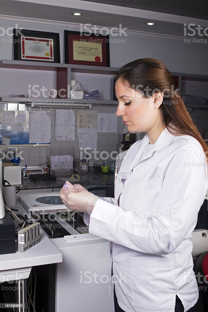 Scientist with blood or urine samples in laboratory royalty-free stock photo