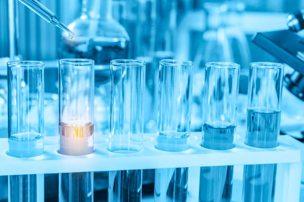scientist with equipment and science experiments, laboratory glassware containing chemical liquid for research or analyzing a sample into test tube in laboratory scientist with equipment and science experiments, laboratory glassware containing chemical liquid for research or analyzing a sample into test tube in laboratory. oncology stock pictures, royalty-free photos & images