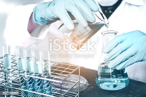 istock Scientist with equipment holding tools during scientific experiment science concept 937138568