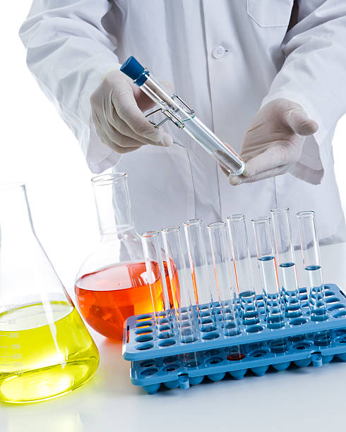 scientist with equipment - carolinemaryan stock pictures, royalty-free photos & images