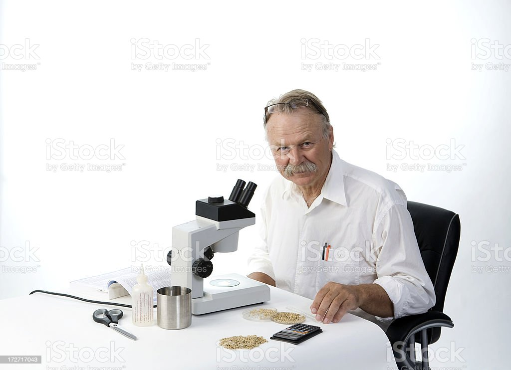 Scientist with microscope royalty-free stock photo