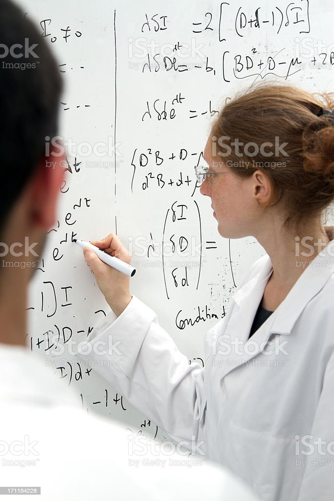 scientist woman  writing equations royalty-free stock photo