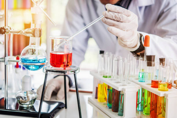 Scientist working at laboratory with chemical containing in beaker and lab test tube Scientist working at laboratory with chemical containing in beaker and lab test tube biochemist stock pictures, royalty-free photos & images