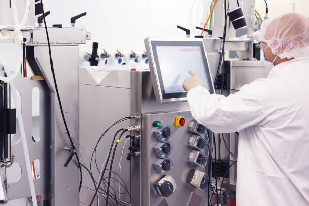 Scientist working in a cleanroom stock photo