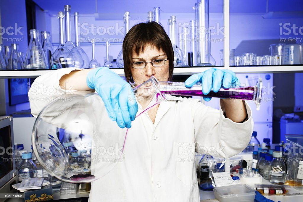 Scientist working in biomedical laboratory royalty-free stock photo