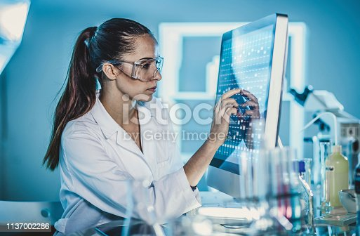 Scientist Working in The Laboratory, Using Touch Screen