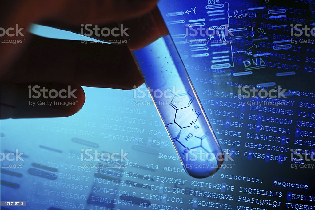 A scientist working on DNA in a test tube stock photo