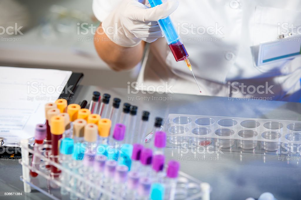 Scientist working with blood samples in laboratory stock photo
