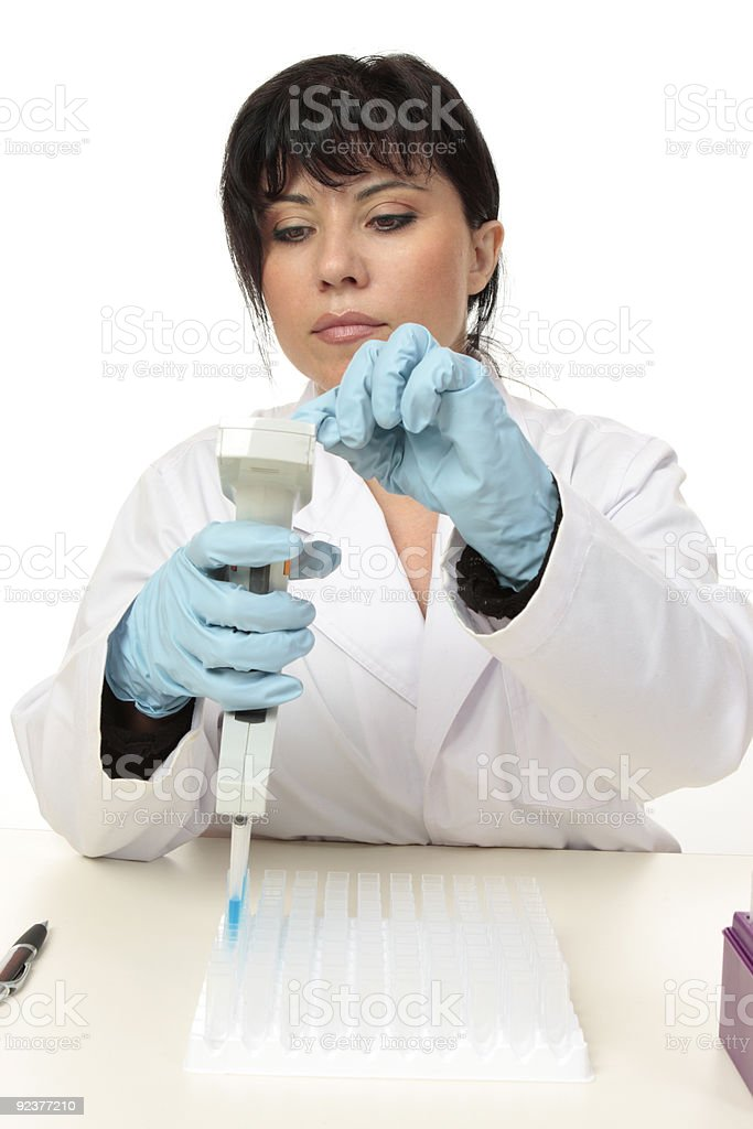 Scientist working with pipette royalty-free stock photo