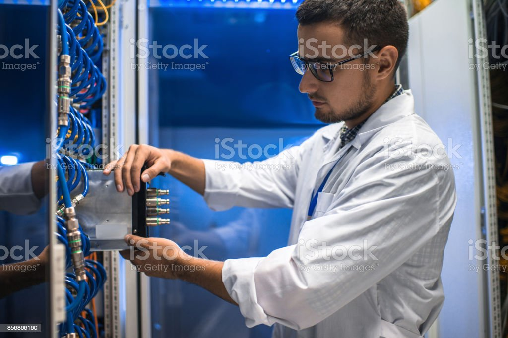 Scientist Working with Supercomputer stock photo