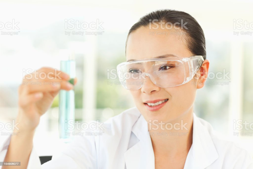 Scientist Working with Test Tubes stock photo