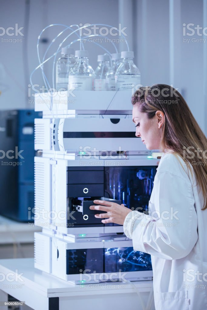 scientist working with vials analysis in the laboratory stock photo