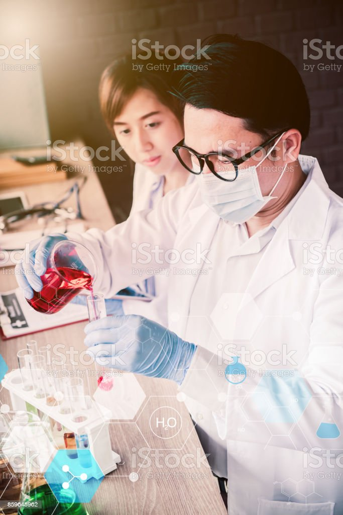 scientistand doctor working in science and chemical for health stock photo