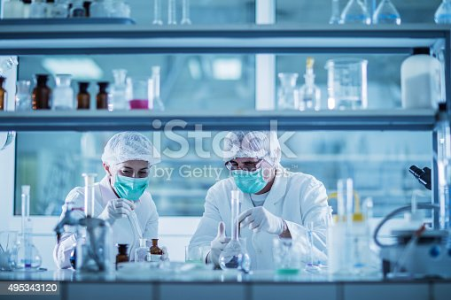 499203366istockphoto Scientists analyzing chemical substances for a new research. 495343120