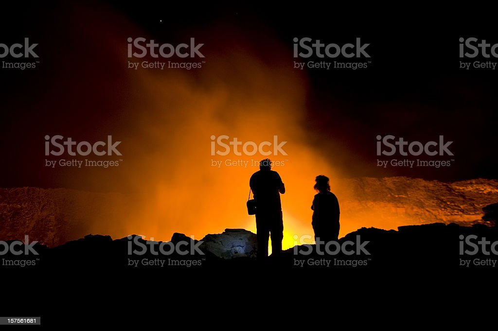 Scientists are looking into the glowing lava-lake of Erta Ale royalty-free stock photo