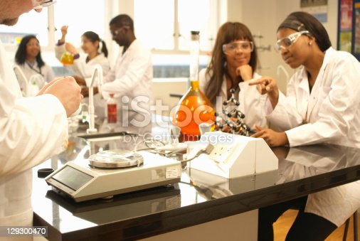 129300487 istock photo Scientists at work in lab 129300470