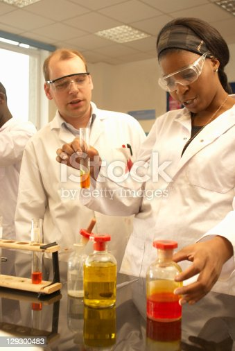 129300487 istock photo Scientists at work in lab 129300483