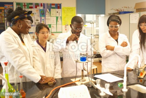 129300487 istock photo Scientists at work in lab 129300487
