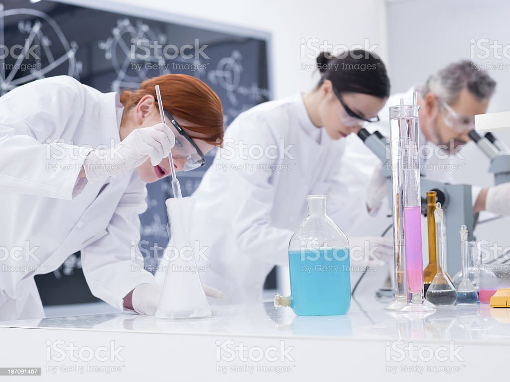 scientists conducting lab experiments royalty-free stock photo