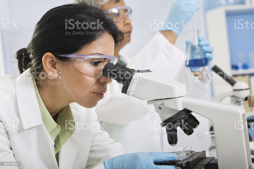 Scientists conducting  medical research experiment in laboratory royalty-free stock photo