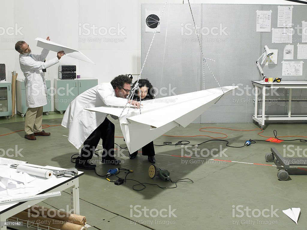 scientists constructing a plane in laboratory royalty free stockfoto