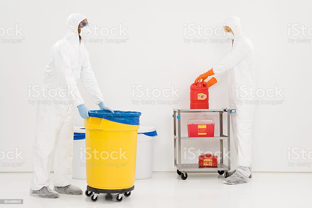 Scientists disposing of chemical waste 免版稅 stock photo