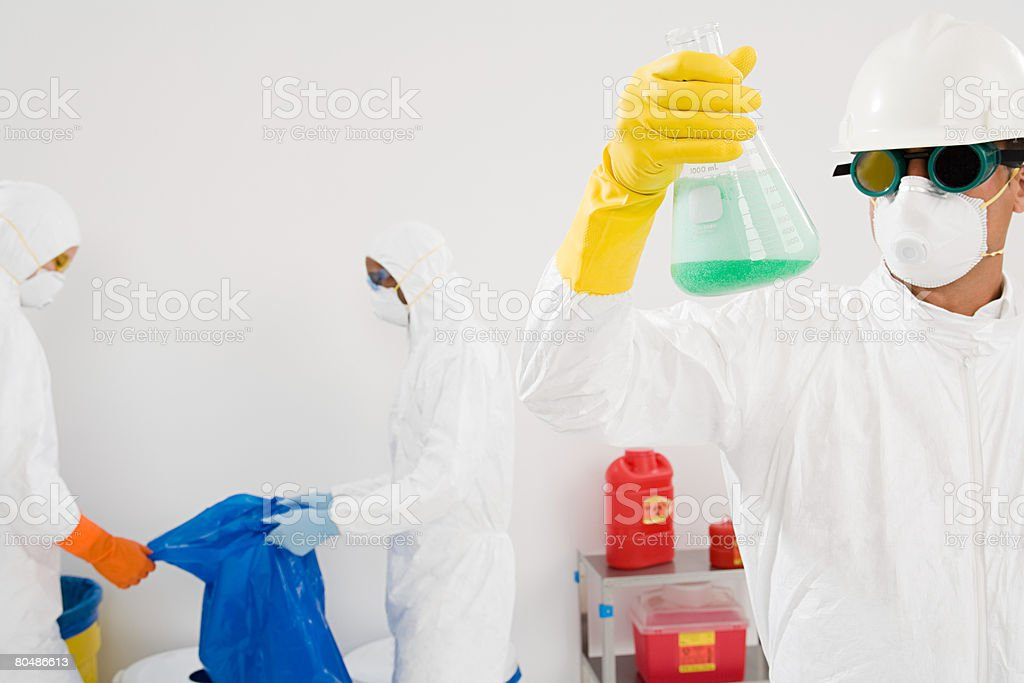 Scientists disposing of chemical waste stock photo