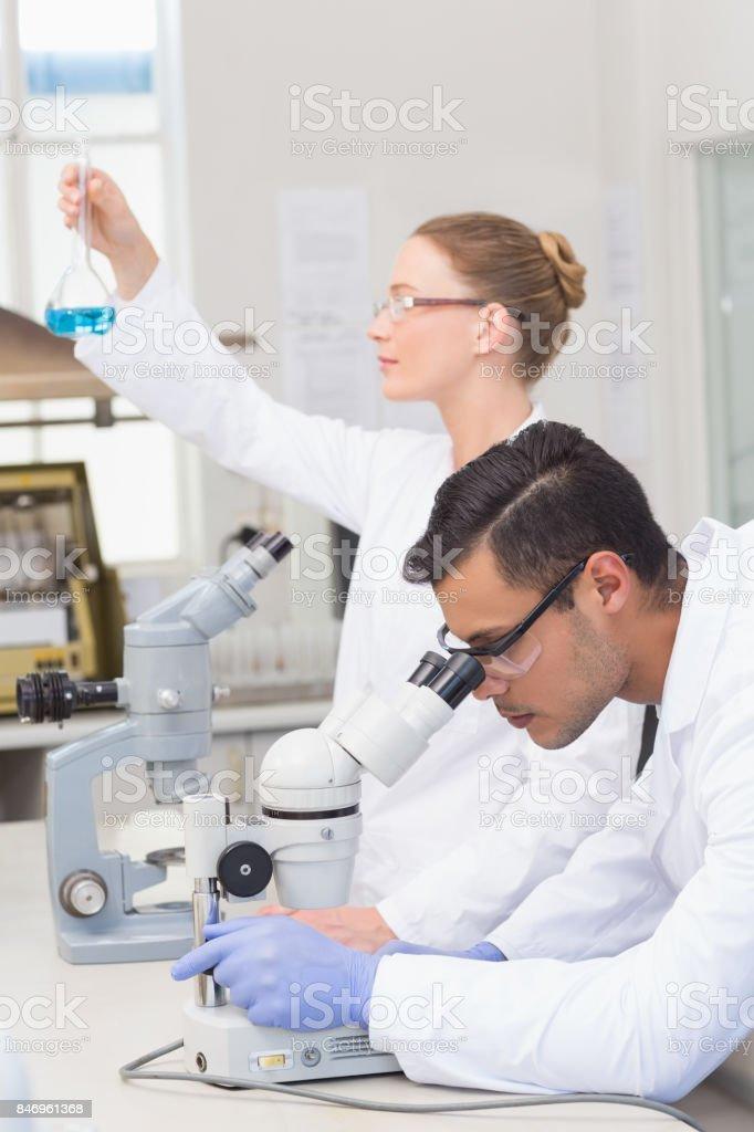 Scientists examining blue precipitate stock photo