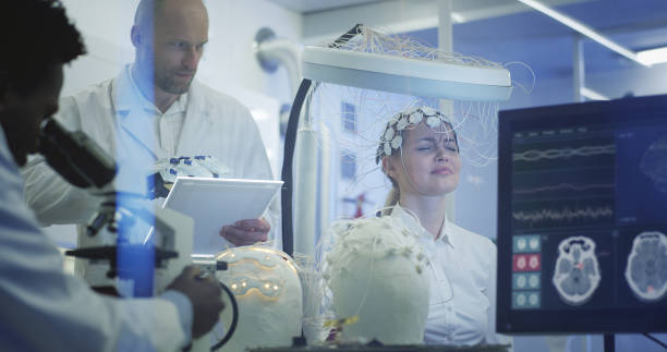 Scientists examining Brainwave Scanning Headset in laboratory. Scientists examines headset in modern Neurological Research Laboratory. neuroscience patient stock pictures, royalty-free photos & images