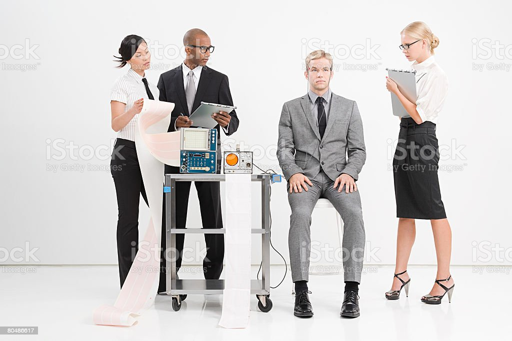 Scientists experimenting on a man stock photo