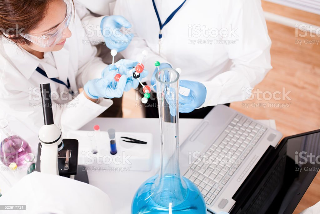 Scientists in research laboratory. Molecular structure. Chemicals, laptop. stock photo