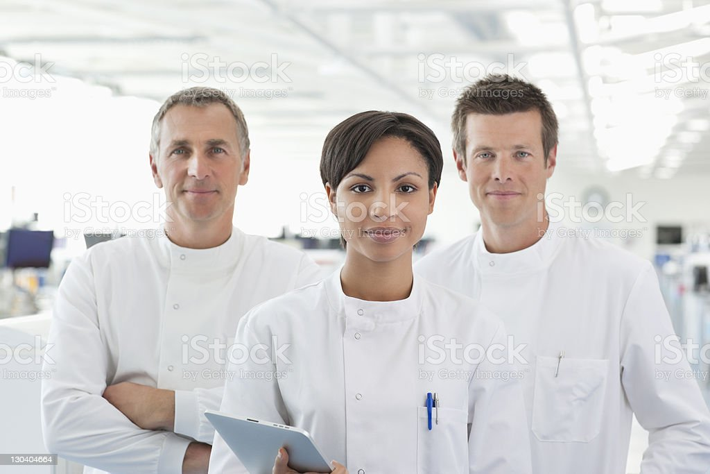 Scientists smiling in lab royalty-free stock photo