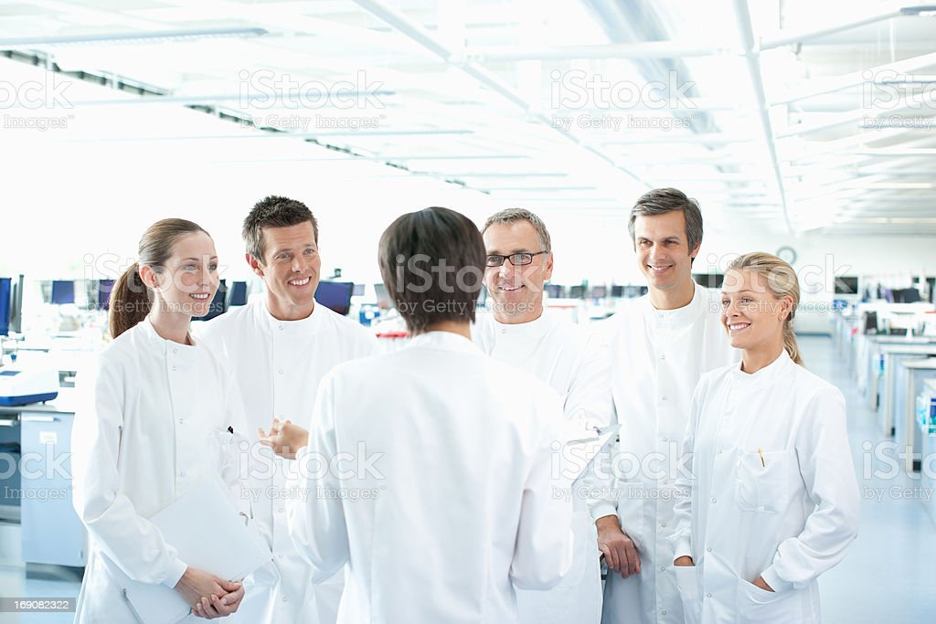 Scientists talking in lab stock photo