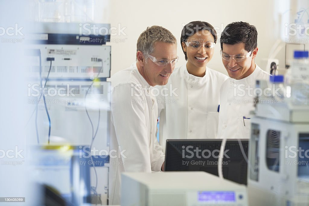 Scientists using equipment in lab royalty-free stock photo