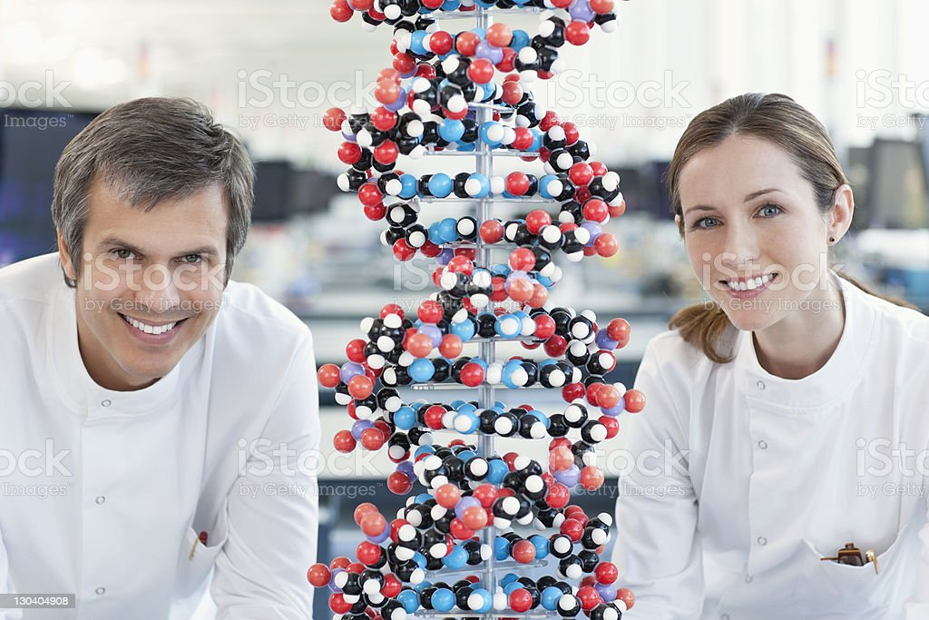 Scientists with molecular model in lab royalty-free stock photo