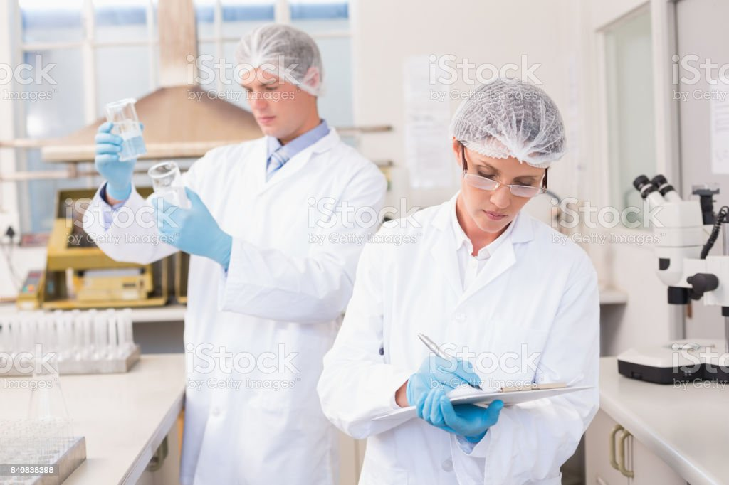 Scientists working attentively stock photo