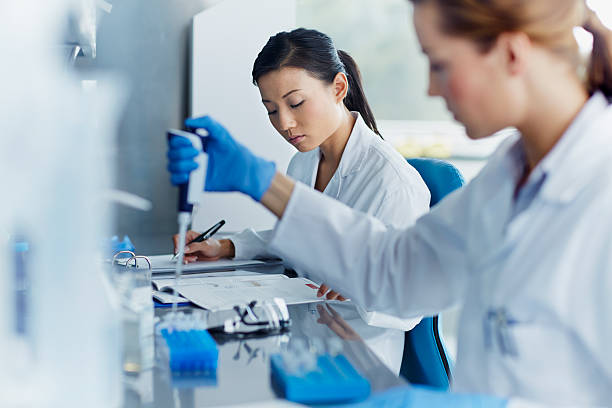 Scientists working in modern laboratory Female scientists working in modern biotechnology laboratory medical research stock pictures, royalty-free photos & images