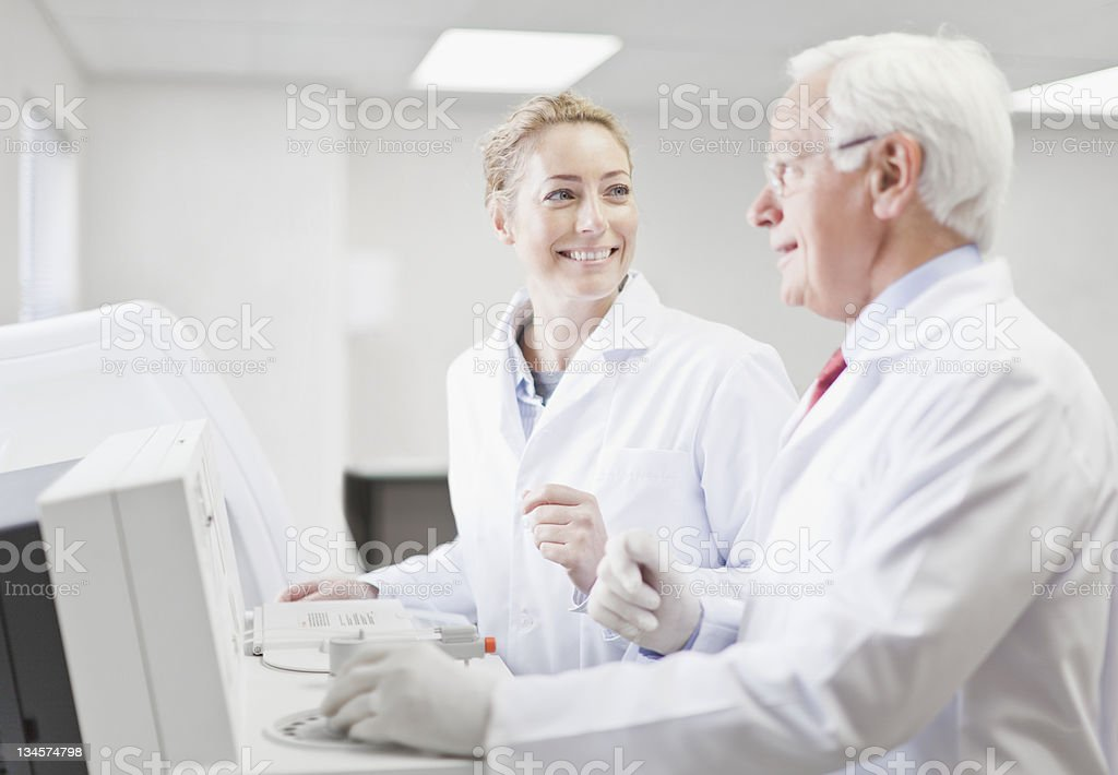 Scientists working in pathology lab stock photo