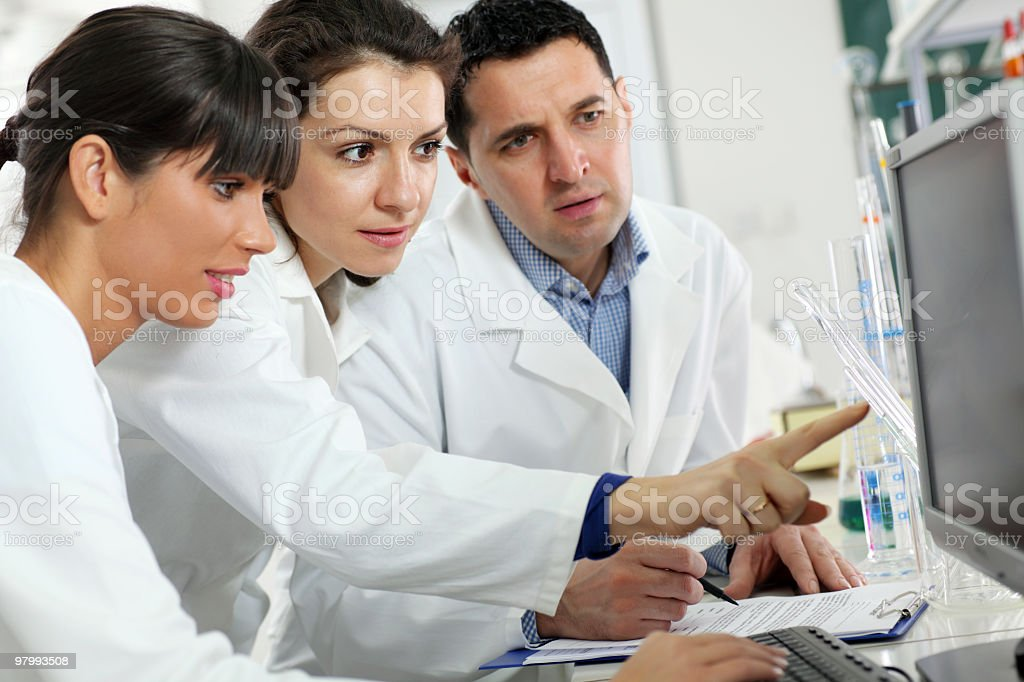 Scientists working on computer in laboratory. royalty free stockfoto