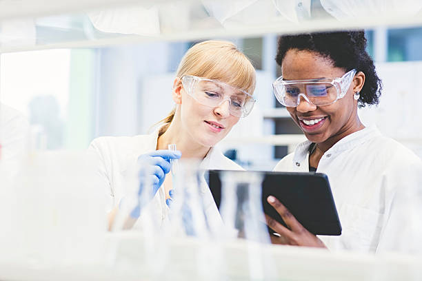 scientists working together in lab - laboratory stock photos and pictures