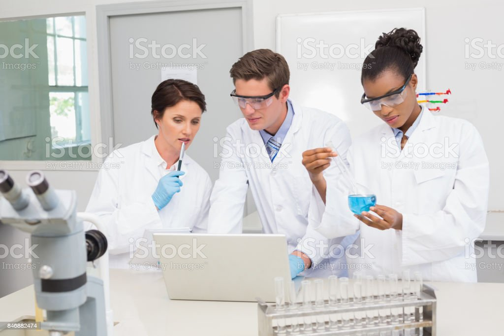 Scientists working together on precipitate tests stock photo