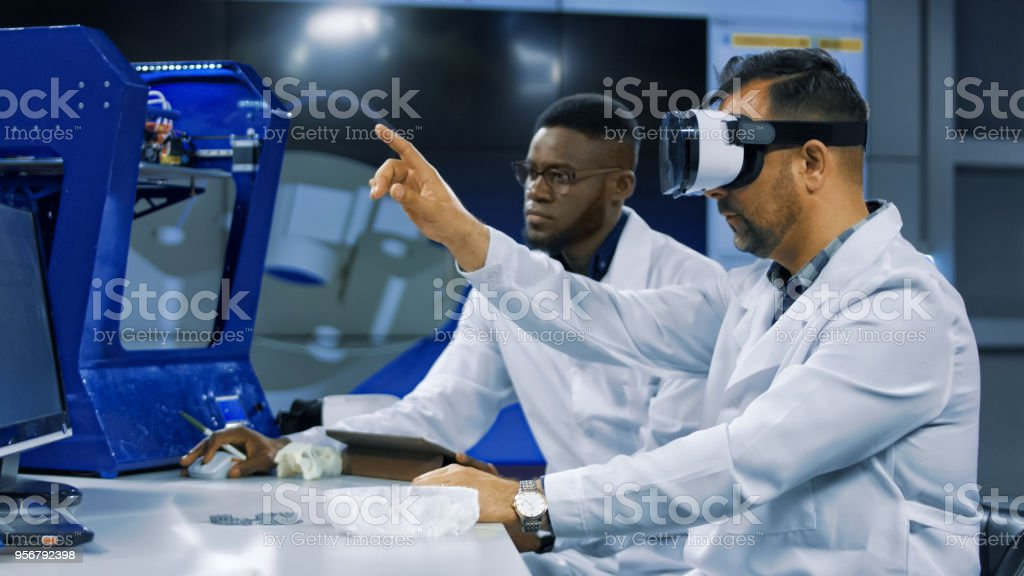 Scientists working with 3d printing and VR stock photo