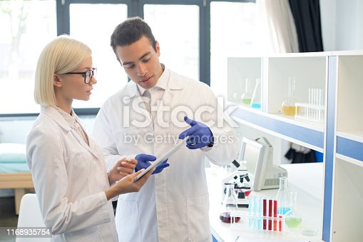 istock Scientists working with tablet in a lab 1168935754