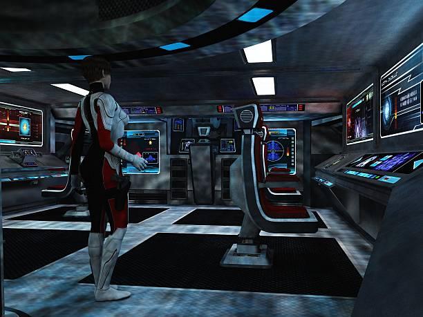 Scifi female trooper in command and control centre stock photo