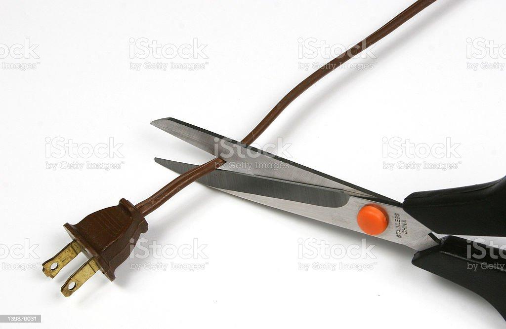 Scissor cutting power cord stock photo