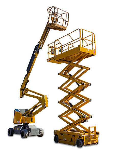 Scissor lift and articulated boom lift Two types of mobile aerial work platform - yellow scissor hydraulic lift and yellow hydraulic articulated boom lift on light background. Isolation. mobile crane stock pictures, royalty-free photos & images