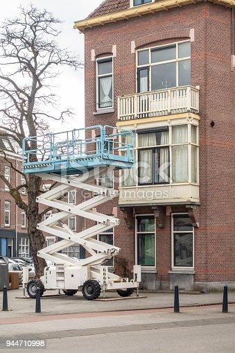 Scissor lift in city of  Rotterdam for Apartment maintenance
